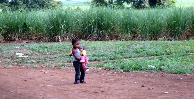 Child carrying child- enhanced
